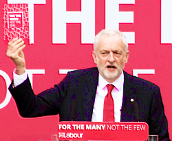 Pic: Corbyn holds up Labour manifesto - click to read worker's rights plan