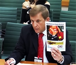 Pic: Dave Joyce holds up latest edityion of CWUv  REport into Dog bites